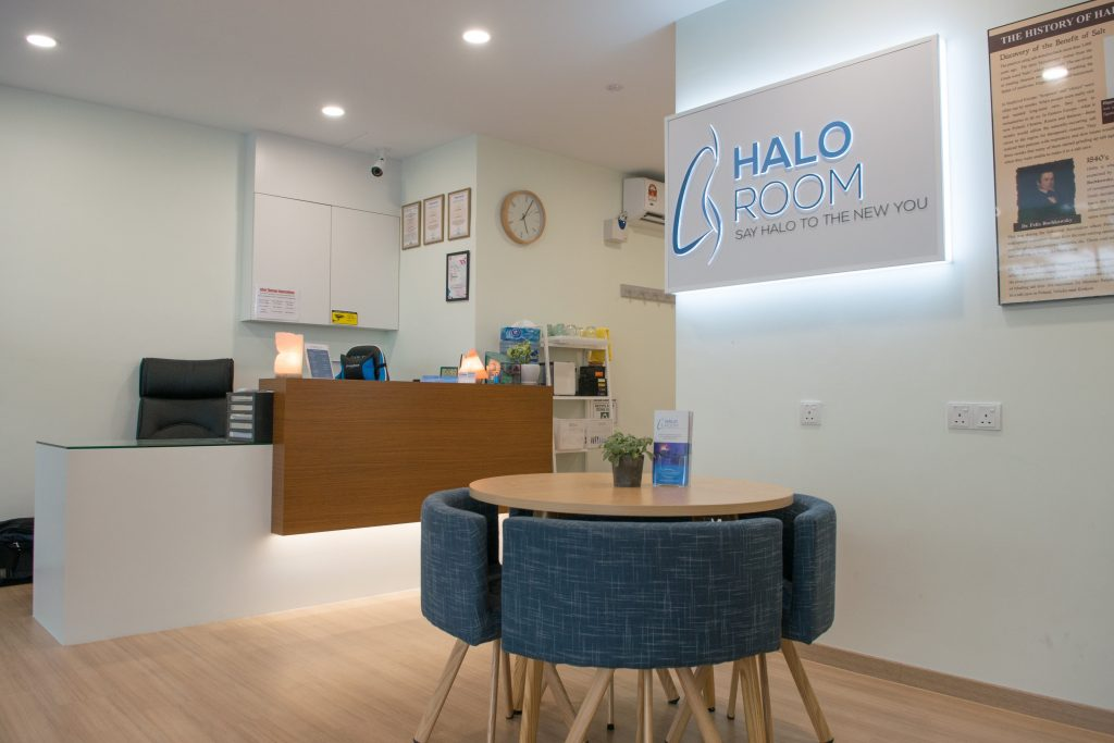 A picture of The Halo Room's lobby, including the reception desk, the signboard, and the waiting area.